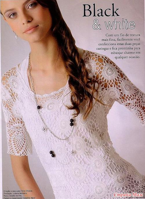 Delicatissima e raffinatissima maglietta bianca all'uncinetto