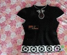 Modello di maglietta stile orientale all'uncinetto.